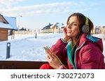 happy winter woman with... | Shutterstock . vector #730272073