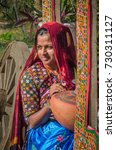 Small photo of KUTCH, GUJARAT, INDIA - 6 NOV. 2014: Young Beautiful Gujarati Kutchi village girl wearing colorful embroidered costume at Rann of Kutch.