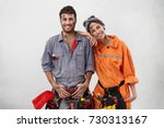 smiling dirty woman leans on... | Shutterstock . vector #730313167