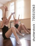 Small photo of Young ballerinas exercises. Sport for girls. Happy ladies stretching in dance class, sensibility from childhood. Gym background, healthy teen lifestyle, femininity concept