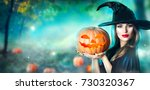 halloween witch with a carved... | Shutterstock . vector #730320367