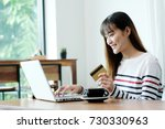 young asian woman holding... | Shutterstock . vector #730330963