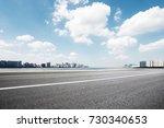 empty asphalt road and... | Shutterstock . vector #730340653