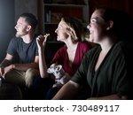 happy friends watching tv with...   Shutterstock . vector #730489117