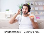 man eating pizza having a... | Shutterstock . vector #730491703