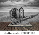 derelict fishing hut on shingle ...