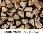 stacked firewood background | Shutterstock . vector #730518763