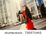 fashion outdoor portrait of... | Shutterstock . vector #730571443
