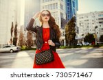 fashion outdoor portrait of... | Shutterstock . vector #730571467