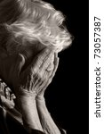sad old women with her hands to ... | Shutterstock . vector #73057387