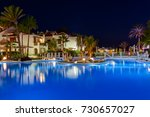 swimming pool at night  ... | Shutterstock . vector #730657027