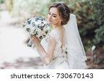 beautiful blonde bride in... | Shutterstock . vector #730670143