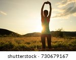 trail runner woman stretching... | Shutterstock . vector #730679167