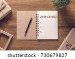2018 goals list in notebook... | Shutterstock . vector #730679827