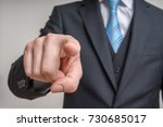 man in suit is looking at... | Shutterstock . vector #730685017