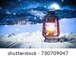 christmas lamp on wooden table... | Shutterstock . vector #730709047