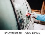 woman removing ice from side... | Shutterstock . vector #730718437