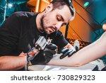 master tattooist makes a tattoo ... | Shutterstock . vector #730829323