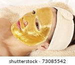 Young Woman With Gold Facial...