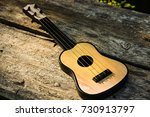 toy acoustic guitar on vintage... | Shutterstock . vector #730913797