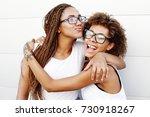two young afro girls having fun ... | Shutterstock . vector #730918267
