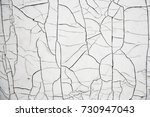 old cracked white paint.... | Shutterstock . vector #730947043