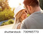 young couple relaxing and... | Shutterstock . vector #730985773