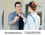 keys being passed between man... | Shutterstock . vector #731039293