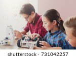 children creating robots at... | Shutterstock . vector #731042257