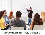 adult man doing presentation in ...   Shutterstock . vector #731045653