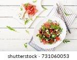 prosciutto di parma salad with... | Shutterstock . vector #731060053