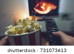 young man watching a movie with ... | Shutterstock . vector #731073613