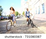 happy funny young couple riding ... | Shutterstock . vector #731080387