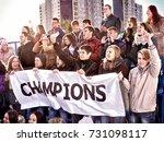 fans cheering in stadium... | Shutterstock . vector #731098117