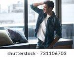 cheerful young man is enjoying... | Shutterstock . vector #731106703
