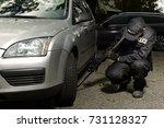 police man checking car floor...   Shutterstock . vector #731128327