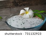 Small photo of Plumeria flower put on silica gel in bowl on old wood, how to flower dried, put silica gel and petal in the container to desiccate, maintain the condition of flower.