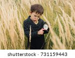 sad boy with a clock in his...   Shutterstock . vector #731159443