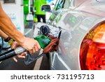car refueling in tank on petrol ...   Shutterstock . vector #731195713