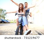 happy funny young couple riding ... | Shutterstock . vector #731219677
