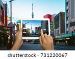 hand holding tablet use ar... | Shutterstock . vector #731220067