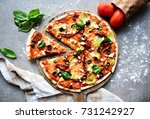 thin pizza on a wooden tray...   Shutterstock . vector #731242927