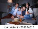 happy family watching tv on... | Shutterstock . vector #731274013