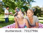 mother and daughter having fun | Shutterstock . vector #73127986