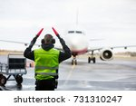 ground crew signaling to... | Shutterstock . vector #731310247