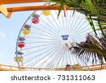Small photo of LOS ANGELES, USA - AUGUST 18, 2017: The ferris wheel in Pacific Park framed by palm trees. Pacific Park is the only amusement park in Los Angeles without an admission fee. Editorial.