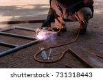 welded steel pipe in the work... | Shutterstock . vector #731318443
