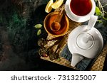from above view of teapot and... | Shutterstock . vector #731325007