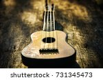 toy acoustic guitar on vintage... | Shutterstock . vector #731345473