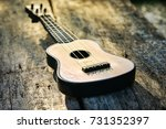 old toy acoustic guitar on... | Shutterstock . vector #731352397